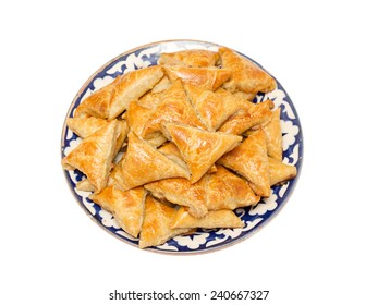 Homemade puff Samosas on a white background