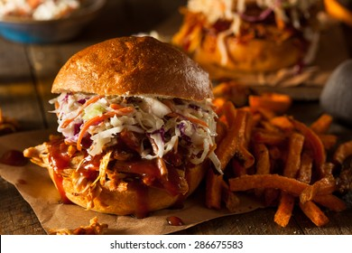 Homemade Pulled Chicken Sandwich with Coleslaw and Fries