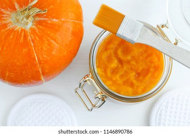 Homemade pumpkin face mask in a glass jar. DIY cosmetics and spa. Top view, Copy space.