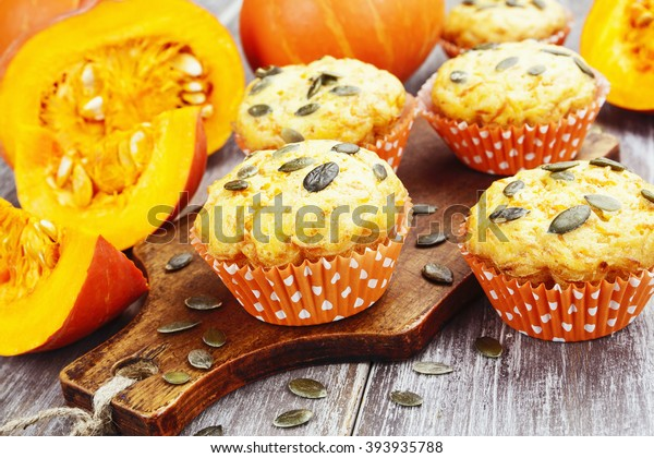 Homemade pumpkin muffins on the wooden table
