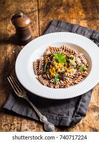 Homemade pumpkin pesto with whole grain spelt pasta.