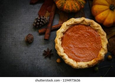 Homemade Pumpkin Pie on Fall Thanksgiving background, Top view