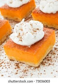 Homemade pumpkin pie with whipped cream. Shallow dof.