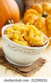 Homemade pumpkin puree in ceramic bowl