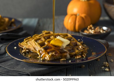 Homemade Pumpkin Spice Waffles with Pecans and Syrup