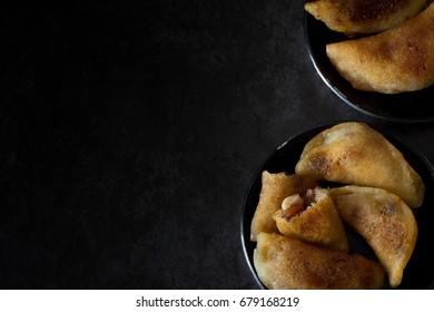 Homemade Qatayef from Above on Dark Background from Above with Copy Space Left