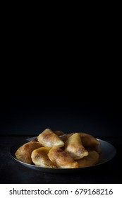 Homemade Qatayef on Dark Background with Copy Space Top Vertical