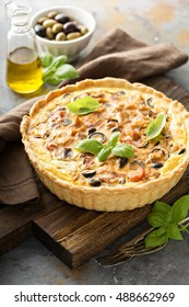Homemade quiche with chicken and caponata made from eggplant and olives