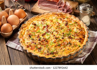 Homemade quiche lorraine with bacon and cheese. French cuisine