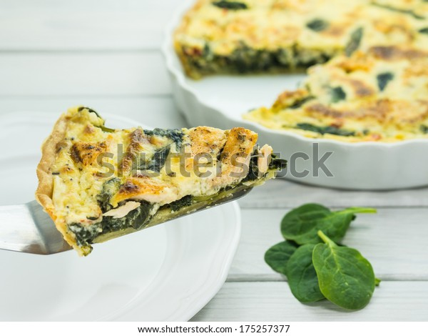 Homemade quiche / tart with salmon and spinach
