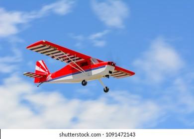 Uçak        Homemade radio control aircraft  on blue sky.