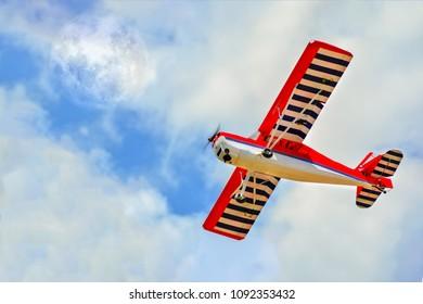 Homemade radio control aircraft on blue sky.