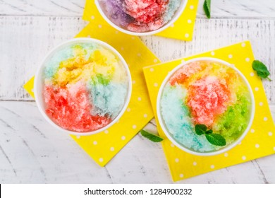 Homemade rainbow shaved ice on white background
