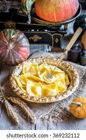 Home-made ravioli or tortelli with pumpkin