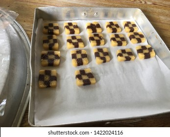 The homemade raw biscuits are yellow and brown.
