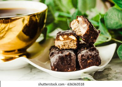 Homemade raw chocolate candy snickers bars. Vegan dessert. Healthy lifestyle and raw food concept