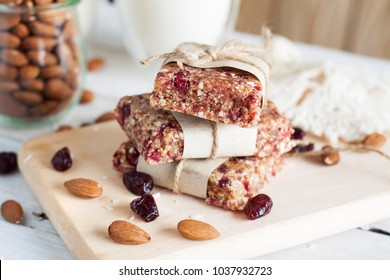 Homemade raw coconut cranberry cashew fig bars. Snack food. Energy bars