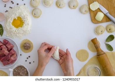 Home-made recipe for dumplings ravioli. Traditionally, woman hold the dumplings in the family. Flat lat frame mock up. hero header pelmeni