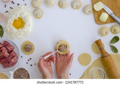 Home-made recipe for dumplings ravioli. Traditionally, woman mold the dumplings in the family. Flat lat frame mock up. hero header pelmeni