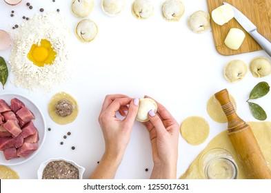 Home-made recipe for dumplings ravioli. Traditionally, woman hold the dumplings in the family. Flat lay frame mock up. hero header pelmeni