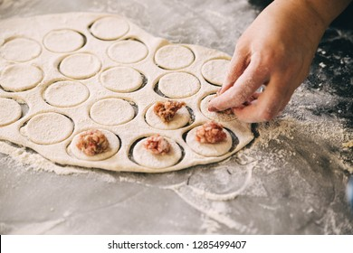 Home-made recipe for dumplings ravioli. Traditionally, woman hold the dumplings in the family. Flat lat frame mock up. hero header pelmeni