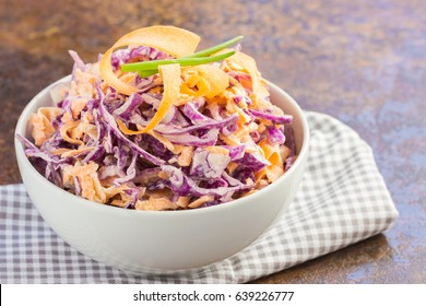 Homemade red cabbage  coleslaw with yogurt dressing in a white bowl.