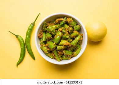 Homemade Red or Green Chilli Pickle also known as Mirchi ka Achar or Loncha, selective focus