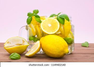 homemade refreshing summer lemonade drink , lemon slices and ice in mason jars