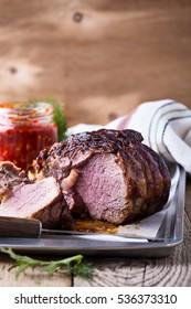Homemade rib-eye boneless roast beef with stuffed mushrooms on baking sheet