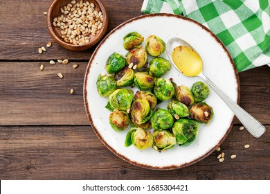 Homemade roasted brussel sprouts with pine nuts and butter sauce