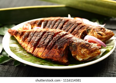 Homemade roasted fish with spices and herbs.