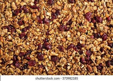 Homemade roasted granola on baking sheet breakfast food background