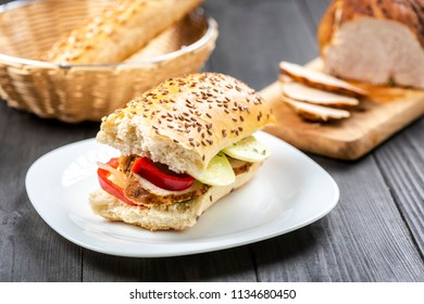 homemade roasted ham sandwich - on a bun with grains
