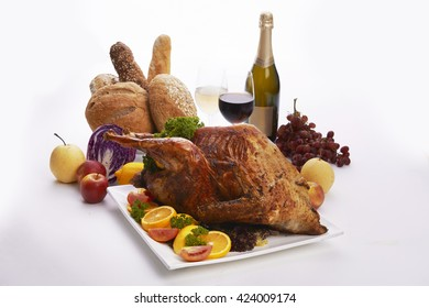 Homemade Roasted Thanksgiving Day turkey with all the sides flavorful fruits and wine on white background
