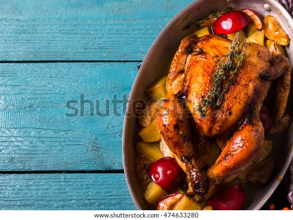 Homemade Roasted Thanksgiving Day Turkey on bright blue wooden background. Style rustic. Top view. Space for text.