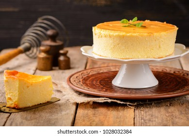 Homemade round cheesecake with mint for dessert - healthy organic summer dessert pie cheesecake. Country style.