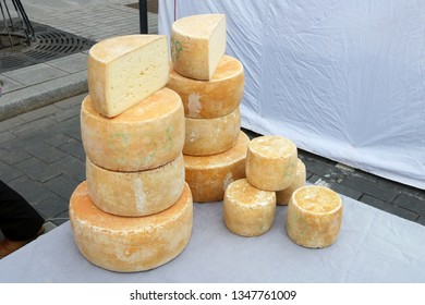 Homemade  rural semi-hard yellow  cheese sold on the street during the traditional spring fair