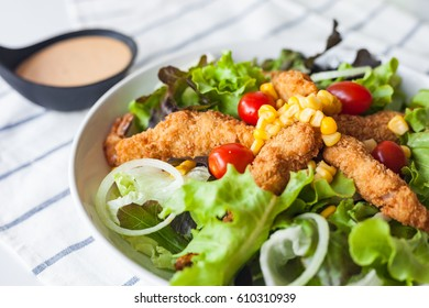 Homemade salad with fried shrimp and cream sauce. Shoot in close up shot on fabric.