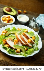 Homemade salad with grilled chicken and avocado