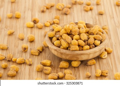 Homemade Salty Corn Nuts in a Bowl on Bamboo background