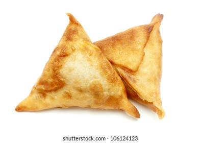 Homemade samosas on a white background