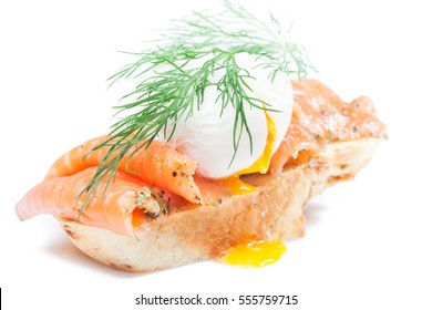 Homemade sandwich with salmon, poached egg and wholegrain bread on isolated white