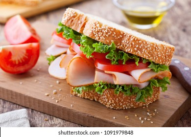 Homemade sandwich with smoked turkey and lettuce