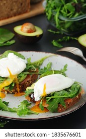 Homemade sandwiches with salmon, avocado and poached eggs