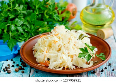 Homemade sauerkraut with carrot and spices on plate, sour white cabbage