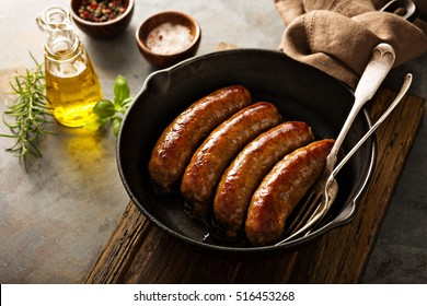 Homemade sausage with italian herbs and cheese in a cast iron pan