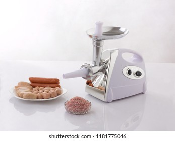 Homemade sausage machine with sausages isolated on white background