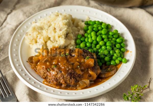 Homemade Savory Salisbury Steaks with Peas and Mashed Potatoes