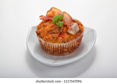 Homemade savoury muffin with bacon on white plate with white background