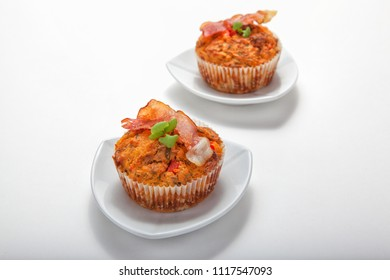 Homemade savoury muffins with bacon on white plate with white background